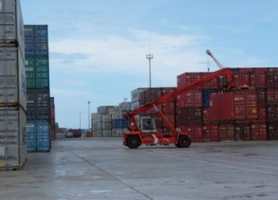 business_a_cargo_container_is_lifted_for_shipping_earlier_this_year_at_the_sihanoukville_autonomous_port_sahiba_chawdhary