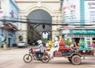 cambodian-men-ride-a-trailer