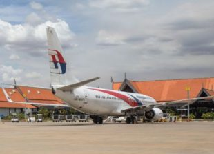 b1_a_plane_sits_on_the_tarmac_at_siem_reap_international_airport_supplied_0