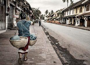 laos-luang-prabang-street-scene-vendor-june-29-2017-630x378