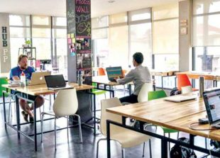 people-work-at-impact-hub-a-co-working-space-in-phnom-penh-that-is-utilised-by-local-startups-in-2015-charlotte-pert